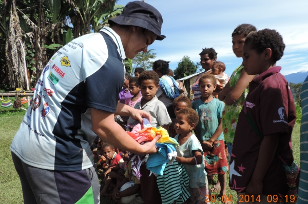 NSW Police Legatees Giving Aid to Children on Kokoda Track ANZAC 2014
